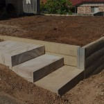 Concrete sleeper wall with Sandstone Steps Retain Terrain